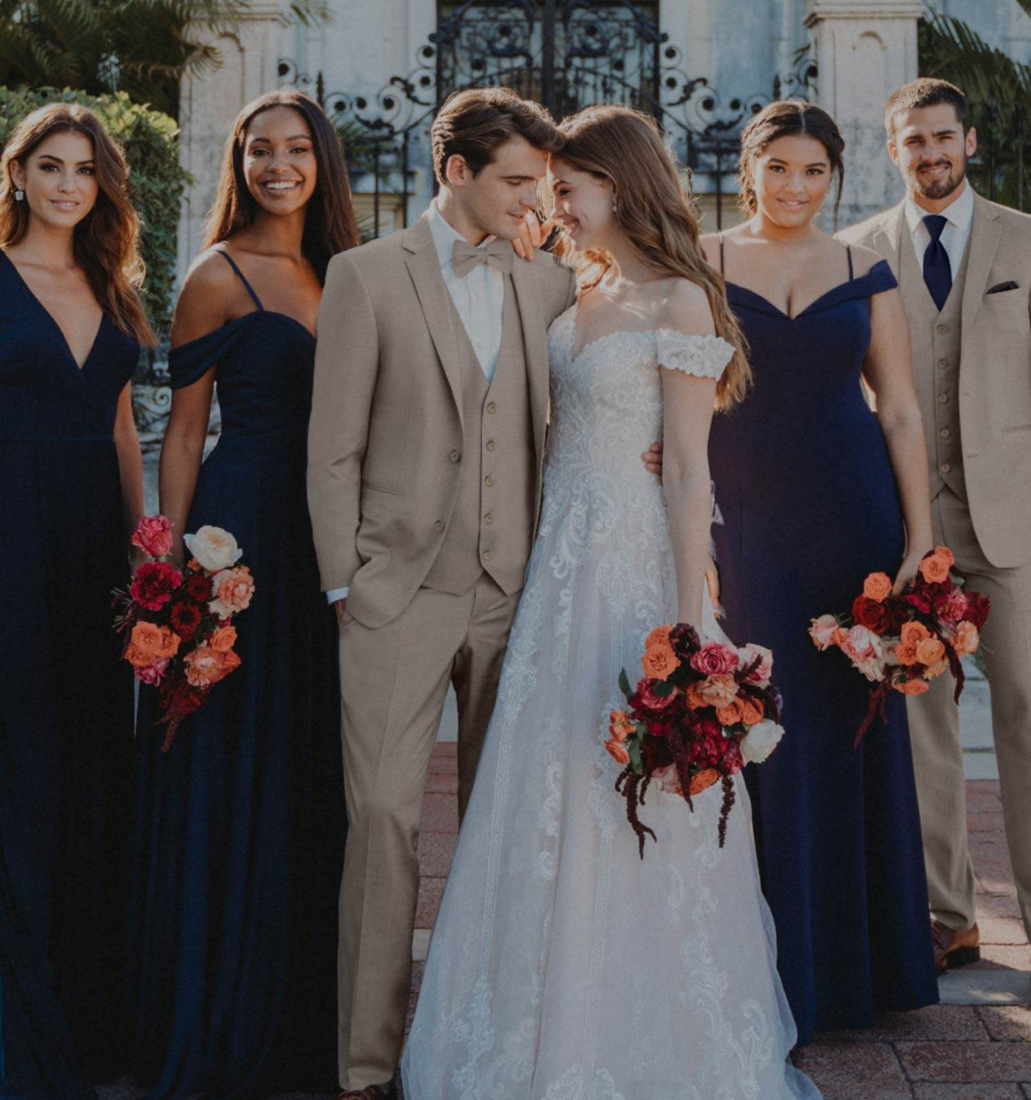 Photo of Michelle's Bridal & Tuxedo Bride, groom and bridesmaids